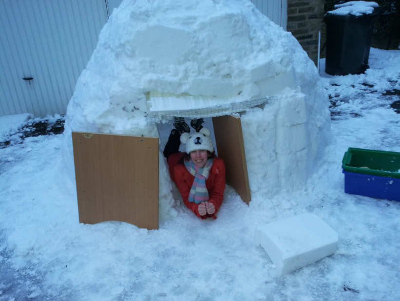 This is the finished result.  We had a LOT of fun in this igloo last year.  Hope it snows as much this year so we can build another one in our new house (and get some better pics)!