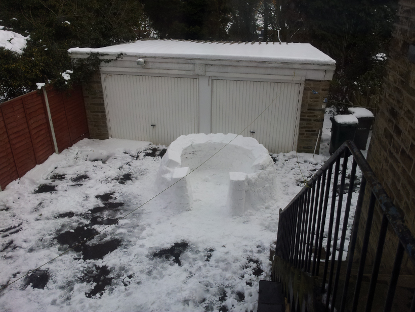 This was what our igloo looked like at our halfway point.  The igloo doorway was improved with bricks set at a different angle for structural stability.
