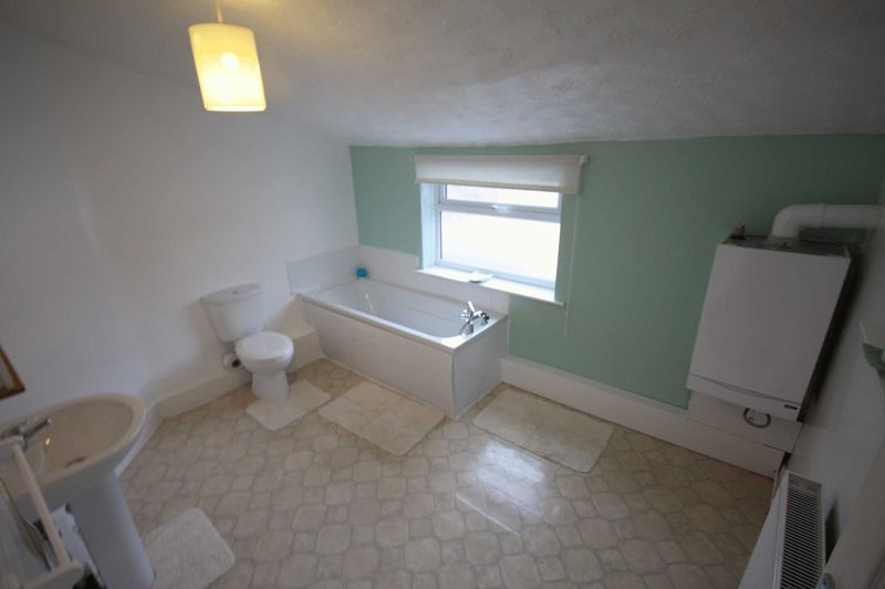 Yodelling? Bowling alley?  Room for a sneaky snooker table?  The real question is, what's the point of the second bath mat??  You can't get out of the bath there.  There's taps in the way.  And a window.  And why are the toilet and bath so close together when there's all this space?