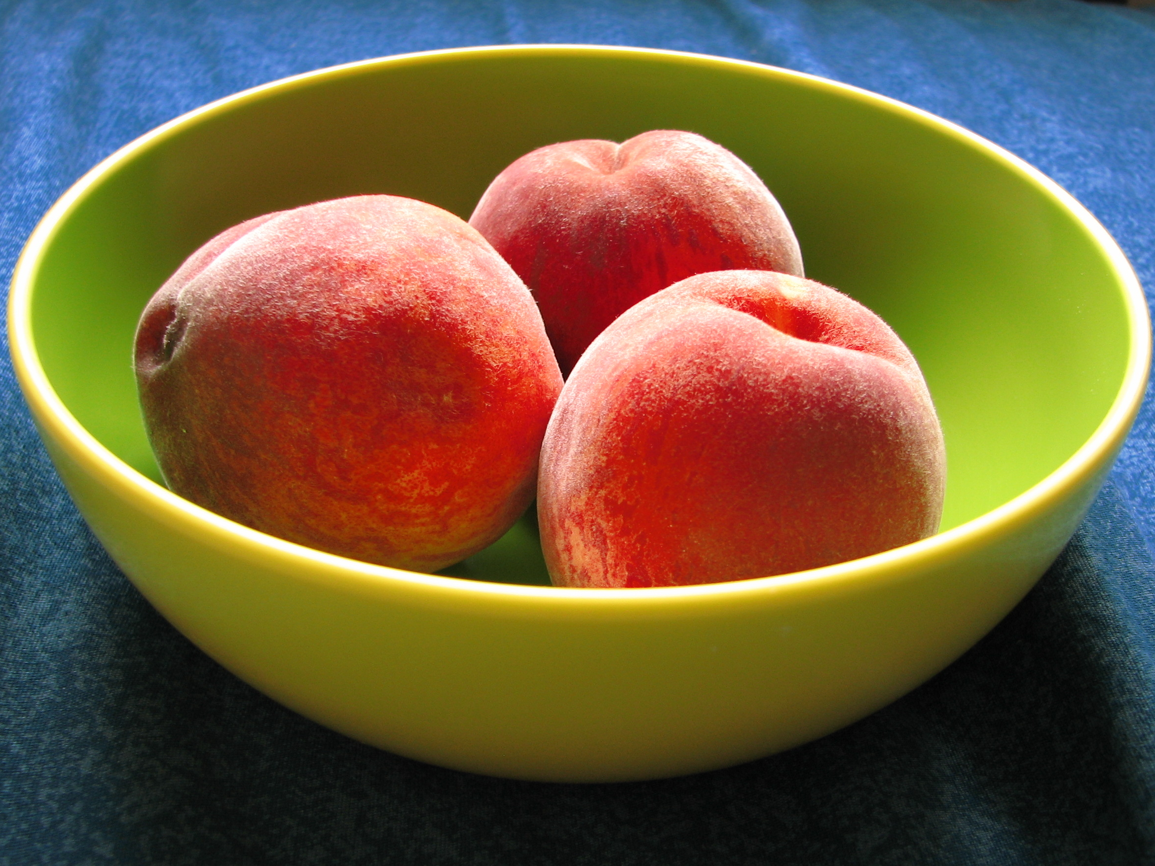 Those peaches have been colour enhanced to make you disappointed if you really see them.