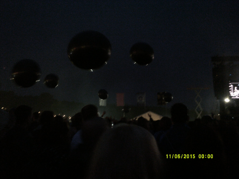 Silver balls released over the crowd.