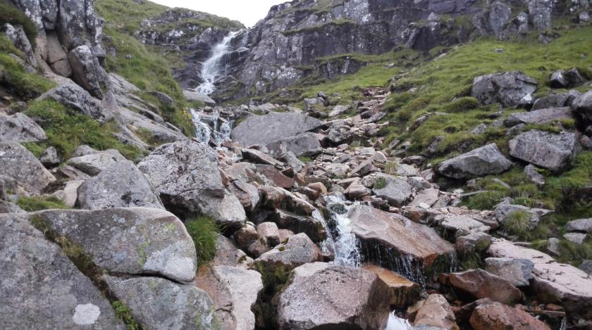 The drinking water fall, from in front of it.