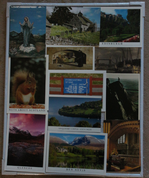 "Travel postcard board - this one is UK themed including The Virgin Mary (top left, it's a postcard from the church in South London that we used to go to, 1989), Patricio Church south Wales (top centre, 2012), Edinburgh Princes Street Gardens (top right, 2010), a red squirrel (left 2011), a picture by El Greco, which hangs in the National Portrait Gallery of Scotland (centre, 2006), a postcard depicting the London Docklands before they built Canary Wharf (right, 1980s), a Scottish ""Forecasting Stone"" (dead centre, 2014) a man at the top of the Roches in Staffordshire (right, 1980s), then Glencoe (bottom right, 2015), Urquart Castle Loch Ness (centre, 2015), Ben Nevis (bottom centre, 2015) and Lincoln Cathedral (bottom right, 2013),"