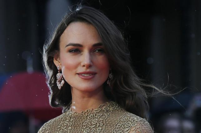 """Actress Knightley poses as she arrives for the European premiere of the film """"The Imitation Game"""" at the BFI opening night gala at Leicester Square in London"""