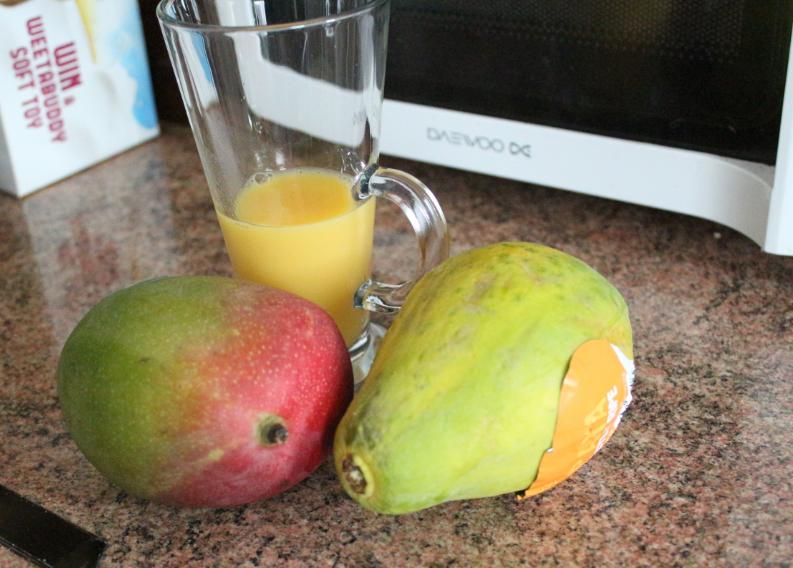 Mango, papaya and orange smoothie invoke delight