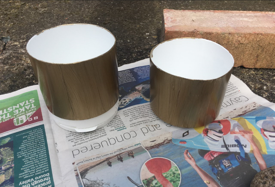 home made cup holders part way through being painted invoke delight and inspire