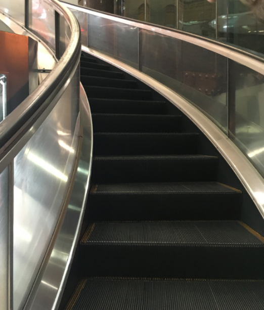 spiral escalator before this one in a Shanghai shopping mall